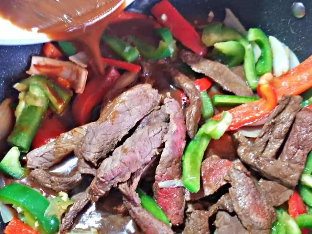 black bean sauce pouring in the pan