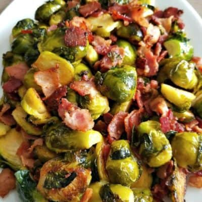 bacon brussel sprouts served on a white plate
