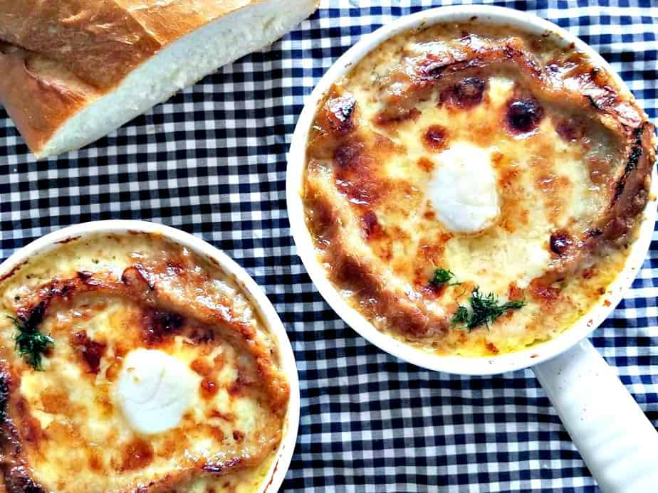French Onion Soup with Broiled Scallops in two bowls
