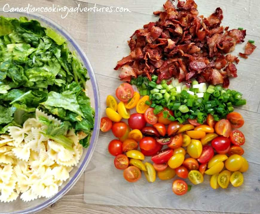 chopped bacon, green onions and baby tomatoes, bow tie pasta and romaine lettuce