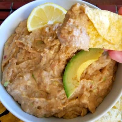 Pinto Bean Guacamole Dip with a tortilla chip