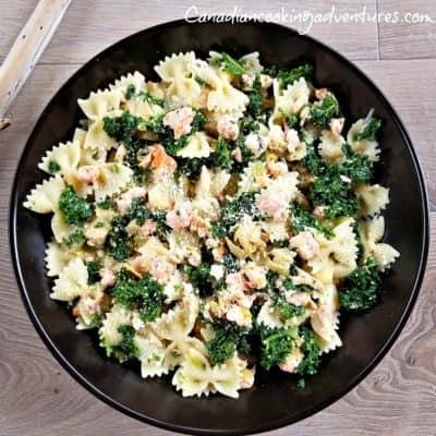 Creamy Bowtie Pasta with Salmon Artichokes and Kale