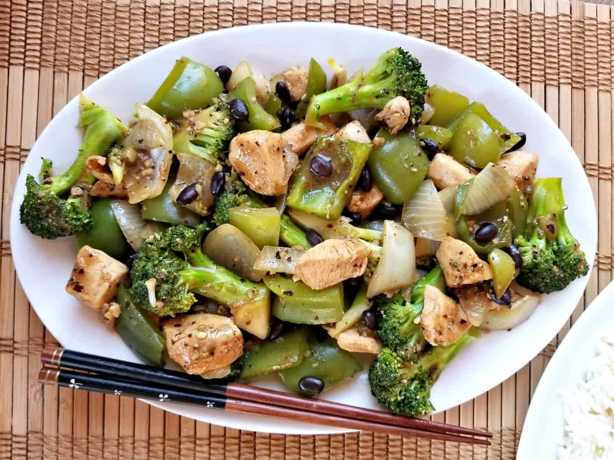 Black Bean Chicken and Broccoli Stir Fry with chopsticks