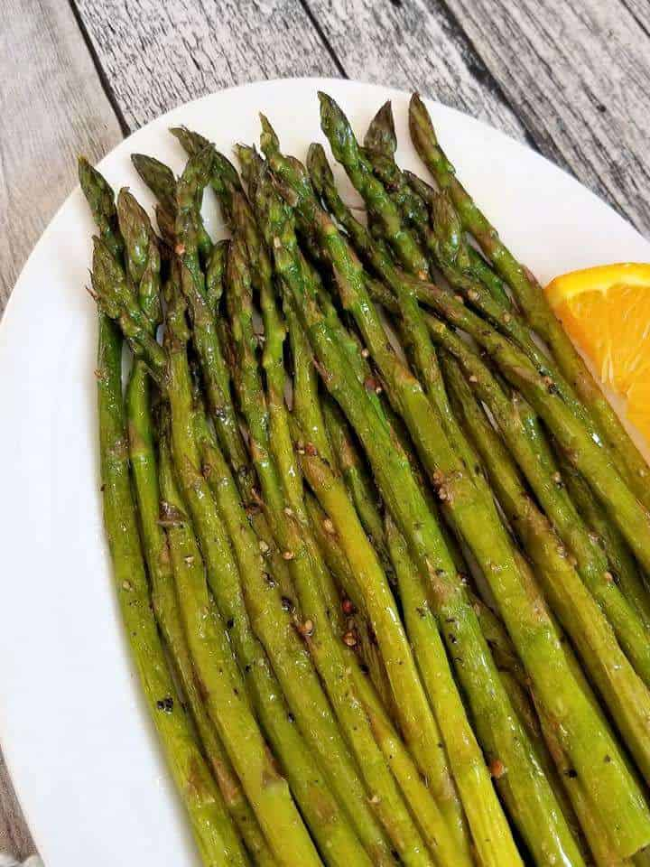 Simple Sauteed Asparagus on a white plate