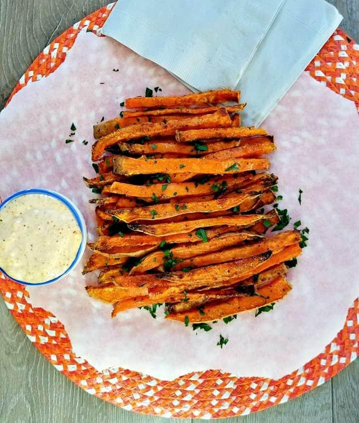 Air Fryer Cajun Sweet Potato Fries on a baking paper